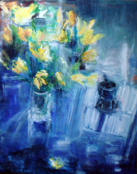 Yellow tulips on blue table